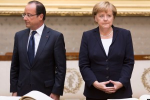 German Chancellor Angela Merkel (R) and the French president Francois Hollande wait to sign their names in the Golden Book at the ceremony on the occasion of the 50th anniversary of Charles de Gaulle's speech to German youth on 22.09.2012 in Ludwigsburg, Germany. In the courtyard of Ludwigsburg Palace 50 years ago urged the franzoesiche President Charles de Gaulle, the solidarity between the two nations, Germany and France.   AFP PHOTO / CARSTEN KOALL